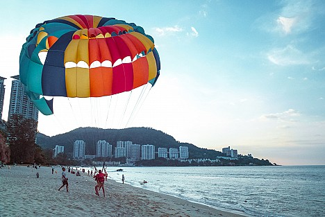 Paraglider landing on a beach
