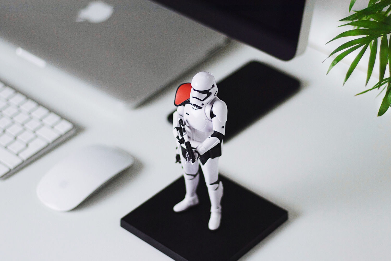 Toy stormtrooper next to laptop
